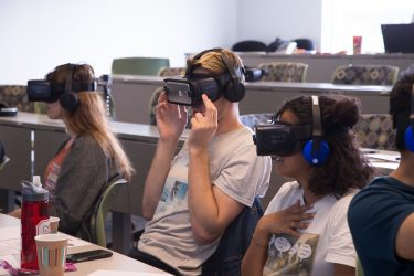 Students use VR headsets in class.