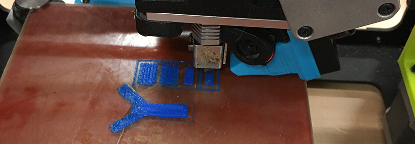 A 3D printer begins to print a blue molecule.
