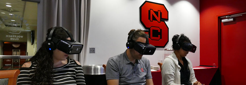 People with headsets on experiencing the virtual reality experience.
