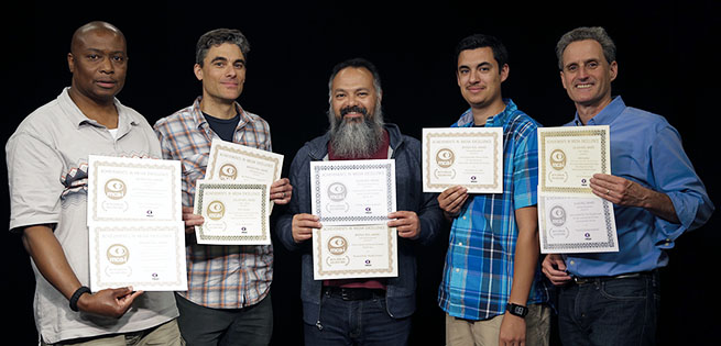 (l-r) Jeff Robinson, Bert French, Arthur Earnest, Michael Castro and John Gordon hold certificates DELTA Video Communications received from MCA-I awards. (Not pictured: Jay Hardy)