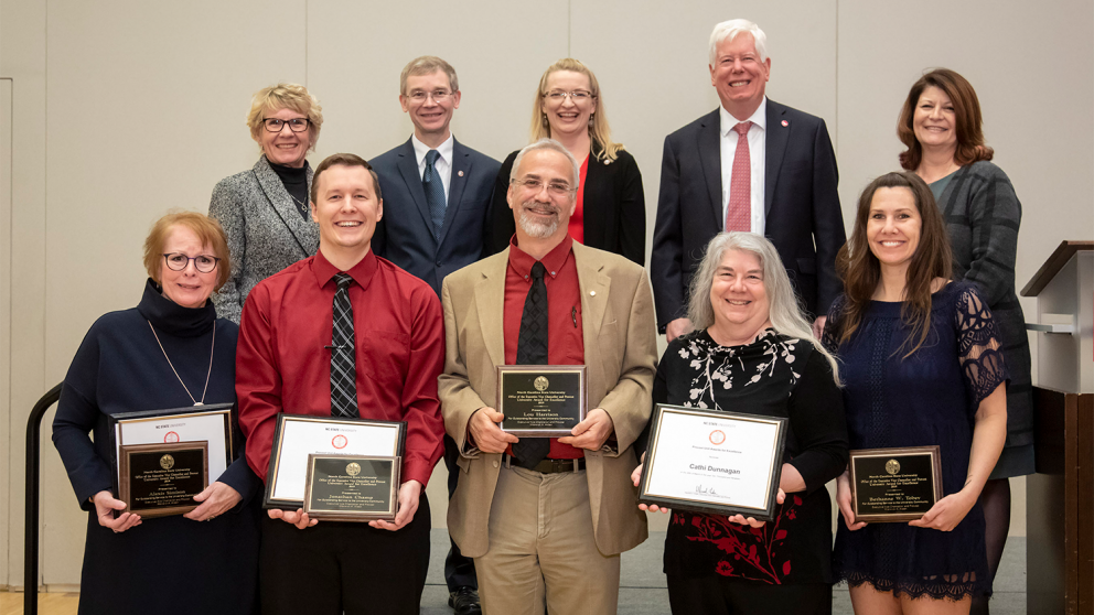 DELTA Awards for Excellence winners with Senior Management team. Top row left to right: Kay Zimmerman, Tim Petty, Donna Petherbridge, Tom Miller, Jessie Sova. Bottom row left to right: Alexis Simison, Jonathan Champ, Lou Harrison, Cathi Dunnagan, Bethanne Tobey.