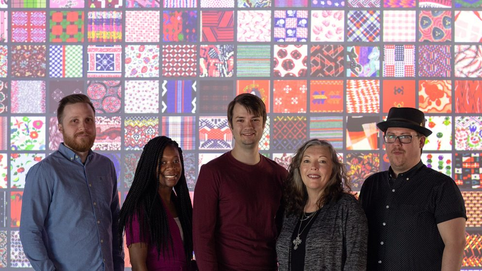 Members of the project team. From left to right: Dan Spencer, Jessica White, David Tredwell, Traci Lamar, Chris Willis. In front of TADA home screen projection.