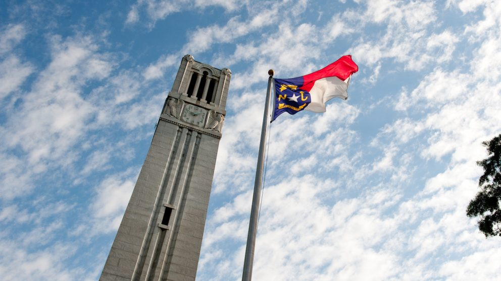 NC State Belltower and flag of North Carolina