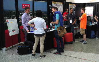 Visitors inquiring about VR at NC State booth at East Coast Games Conference