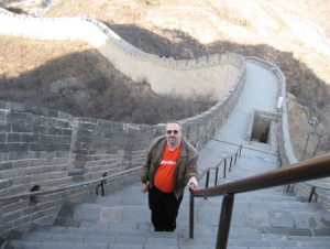Harrison standing at the Great Wall of China