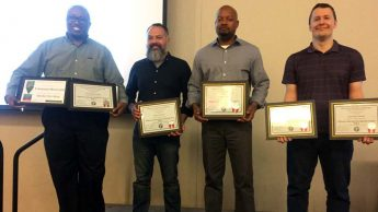 Four DELTA employees are pictured with their certificates for completing Pathways Leadership programs
