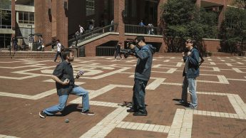 Todd Buker directs camera operator Michael Castro in shooting of