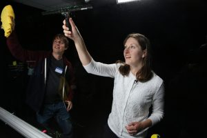 Photo of CE 332 instructor and Todd Buker cleaning the Lightboard