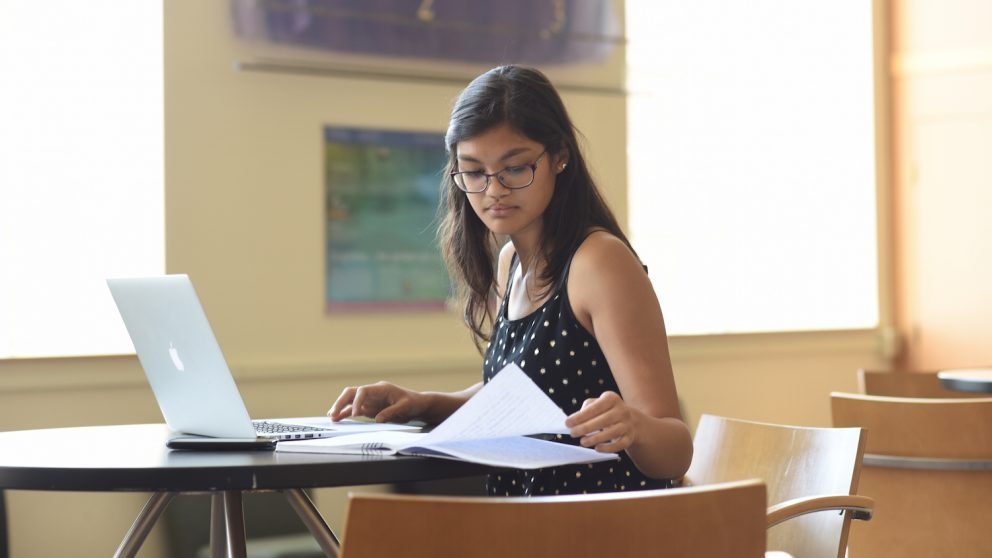 Photo of student working on her computer