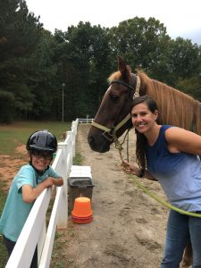Photo of Bethanne Tobey at Helping Horse with Cole and a horse named Tucker