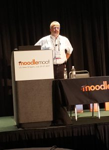 Photo of Lou Harrison presenting at Moodle Moot.