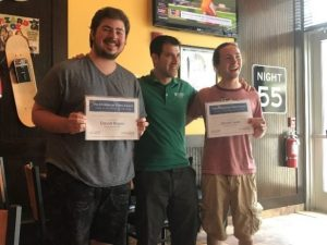 Photo of Jacob Leya (right) and David Rajaski (left) with their scholarships