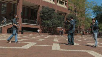 Todd Buker directing, Michael Castro filming professor in Statistics juggling