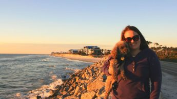 Katie Bean and her dog named Coco Bean at St. George Island, Florida by the ocean.