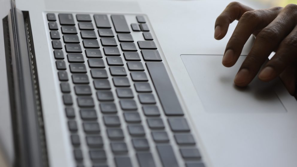 photo of hand on laptop