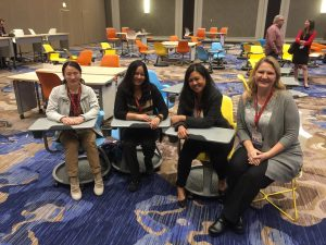 Photo of Yan Shen, Jakia Salam, Arlene Mendoza-Moran and Rebecca Sanchez between sessions at the ELI Annual Meeting.