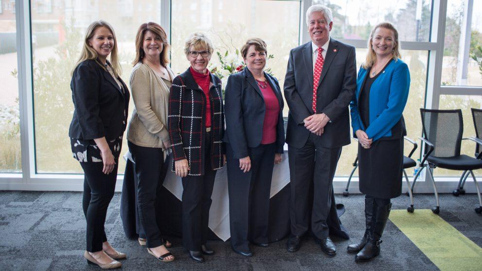 Photo of DELTA's Senior Management Team at Rebecca Swanson's retirement celebration.