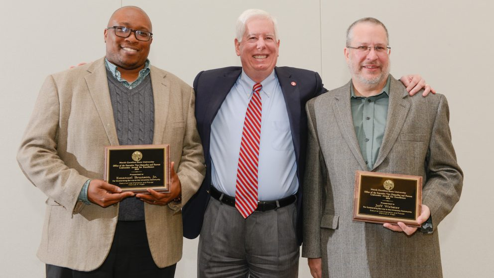 Awards for Excellence recipients Emanuel Brunson (left) and Jeff Webster (right) pictured with Senior Vice Provost Tom Miller (center) at the reception ceremony March 21, 2018 in Talley Student Union. Photo by Marc Hall.