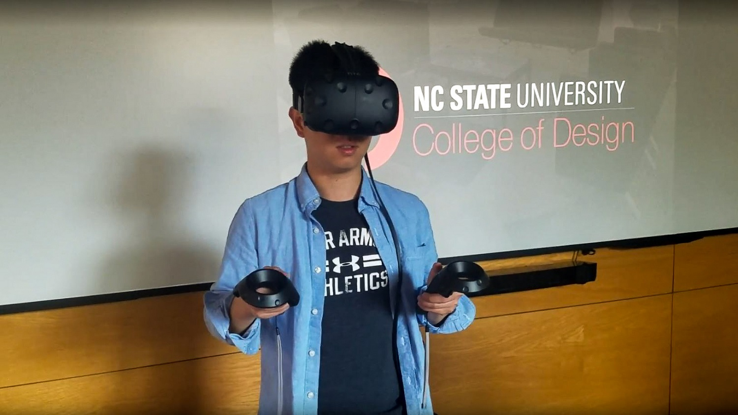 NC State graduate student in architecture Hao Lin experiences a landscape design in virtual reality using HTC Vive.
