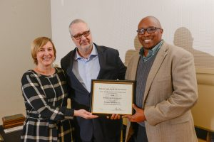 L-R: Stacy Gant, Provost Warwick Arden, Emanuel Brunson. Emanuel receiving his award. Photo by Marc Hall.