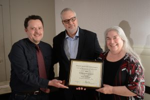 L-R: Daniel Davis, Provost Warwick Arden, Cathi Dunnagan. Cathi receiving award. Photo by Marc Hall.