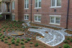 The completed rain garden at Syme Residence Hall.