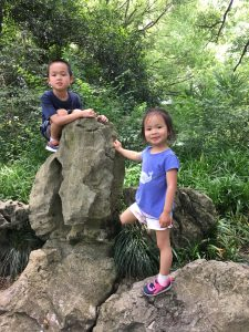 Yan's kids, Charlie and Julia, on a rock.