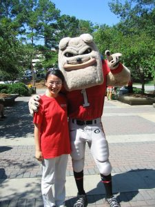 Yan and the UGA costumed mascot standing together.