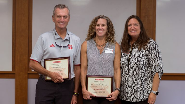 Michael Kanters and Amanda Edwards with recognition awards for service as 2016-2018 DELTA Faculty Fellows with 2017-2019 Faculty Fellow Angie Smith