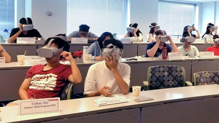 A group of students experience the First Impressions virtual reality module.