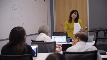 Yiling Chappelow at front of class leading a workshop.