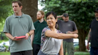 Arlene Mendoza-Moran plays disc golf at the 2018 DELTA Staff Picnic.