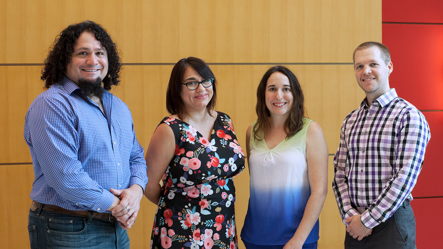Image of DELTA 2018-2019 DELTA Faculty Fellows in the CTI lobby. Standing left to right: James McConnell, Melissa Ramirez, Stacy Supak, and Justin Post.