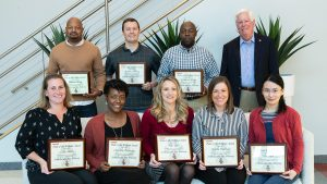 2018 Pride of the Wolfpack Recipients pictured with Senior Vice Provost Tom Miller. Back row left to right: Shawn Colvin, Jonathan Champ, Tremayne Grimes and Tom Miller. Front row left to right: Leisa Bolles, Charlene Pettiway, Allie Giro, Angela Hallman and Yan Shen.