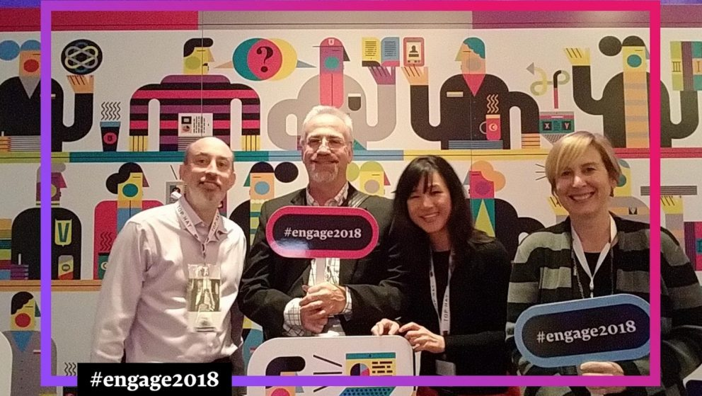David Howard, Lou Harrison, Yiling Chappelow and Stacy Gant at the Engage 2018 conference. The team is holding props in front of a photo booth screen.