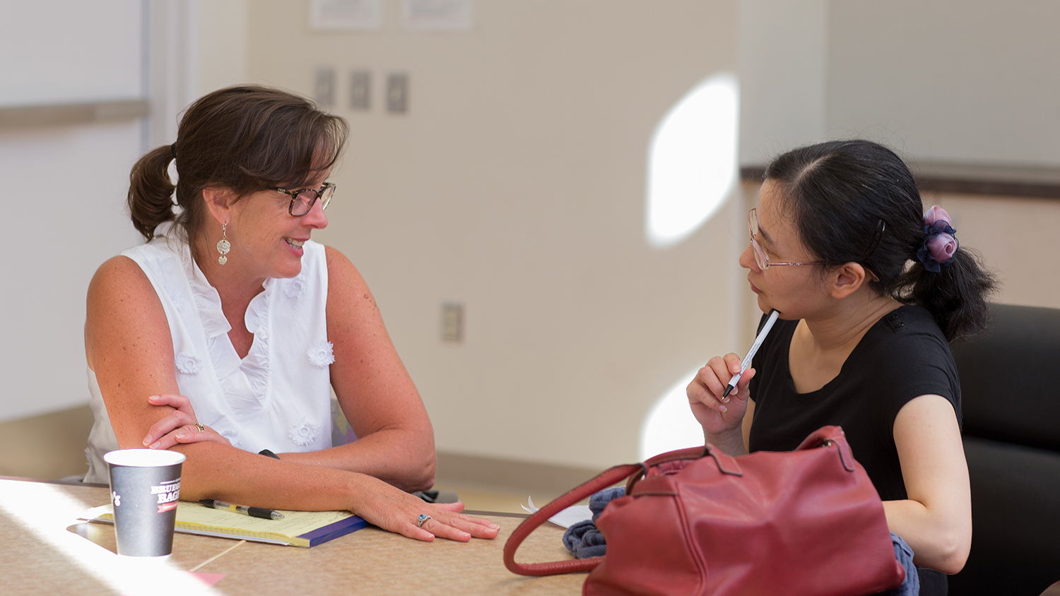 DELTA staff member Yan Shen works with a faculty member at the DELTA Grants Orientation.