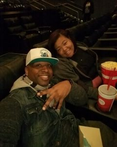 Tamara and her husband smiling at the movie theater