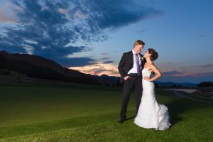 Monica and Kevin pictured posing at sunset at their wedding.