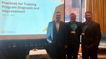 Jason Cook, Michael Von Bargen and Richard Singer at the International Society for Performance Improvement (ISPI) Annual Conference in New Orleans in April 2019. The group is set to graduate from the Master of Education in Training and Development program this May. The three are pictured in front of their presentation screen.