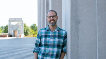 Alan McCoy pictured leaning up against a pillar on Centennial Campus.