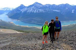 Janna and friends pose in front of an oxbow river and mountains.