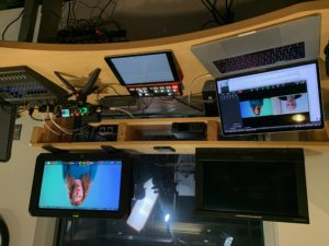 Three monitors display a video in the process of being made at IMP's control room.