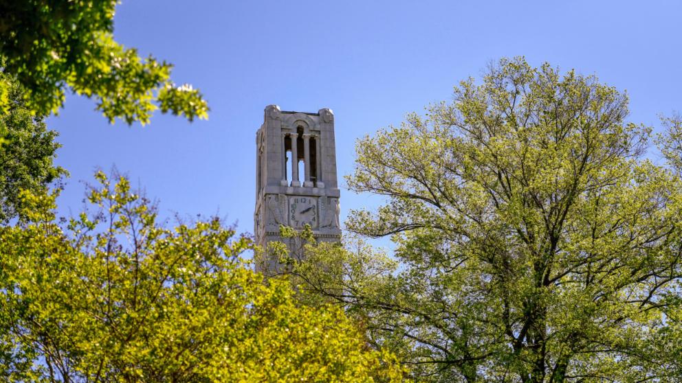 The Belltower framed by spring leaves.