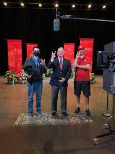 Michael Castro, Chancellor Randy Woodson and Derek DeStefano film on set at Stewart Theater.