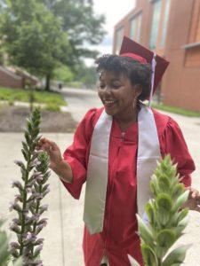 Wynter Adams feels flowers in graduation attire