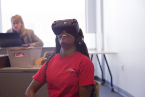 Students use virtual reality headsets for the First Impressions Virtual Reality Module.