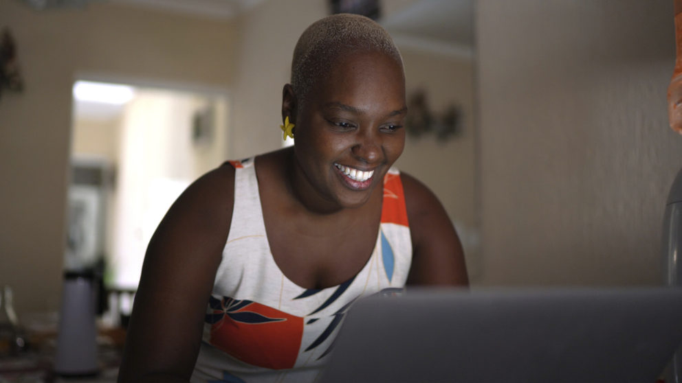 Portrait of mid adult woman using laptop at home