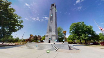 The NC State Memorial Belltower with digital annotations.