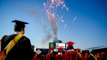 Spring 2021 graduates watch as fireworks shoot at Carter-Finley Stadium.