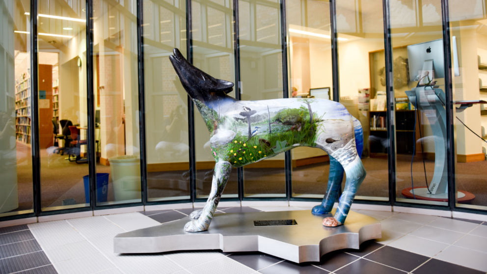 In the lobby of the College of Natural Resources, stands a painted wolf. Photo courtesy of Becky Kirkland.